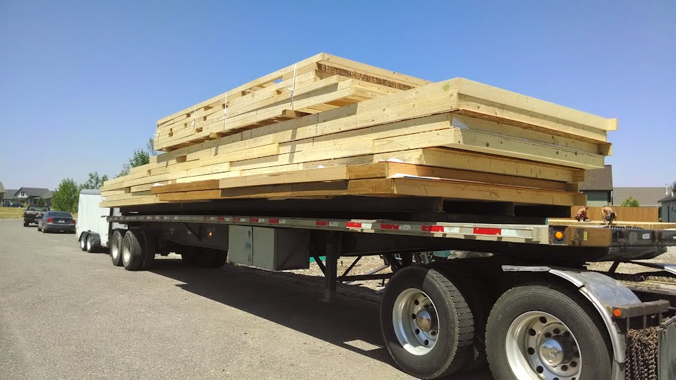 flatbed trailer loaded with prefab wall sections