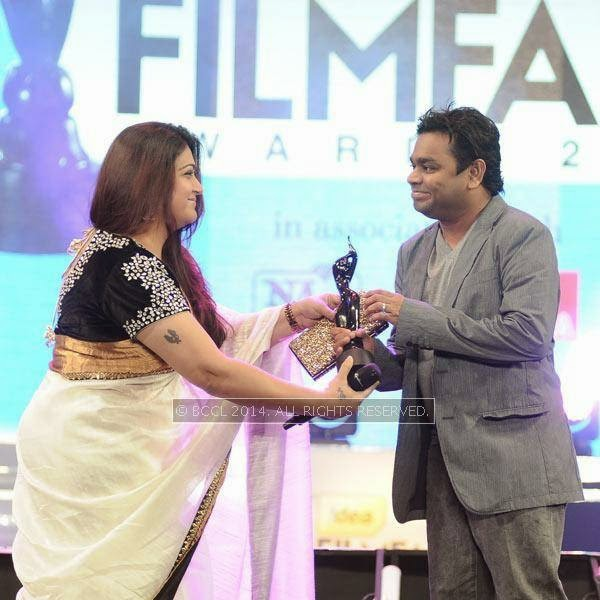 Khushbu presents the award to Best Music in Tamil to AR Rahman for the film 'Kadal' during the 61st Idea Filmfare Awards South, held at Jawaharlal Nehru Stadium in Chennai, on July 12, 2014.
