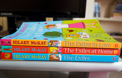Spines of The Exiles, The Exiles at Home and The Exiles in Love by Hilary McKay