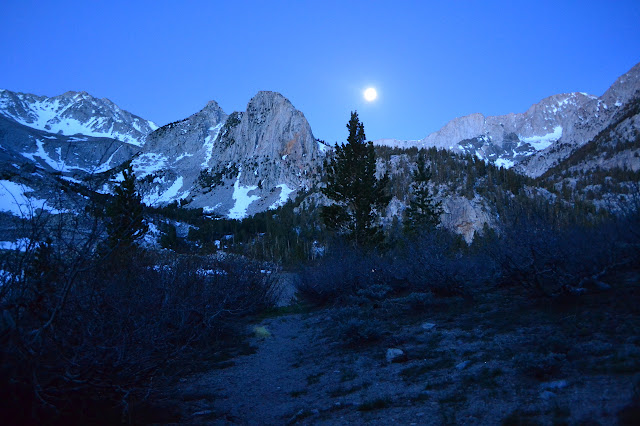 campsite view of moon over Sierras
