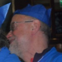 Man wearing blue paper hat
