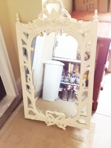 A white framed wood mirror before painting red