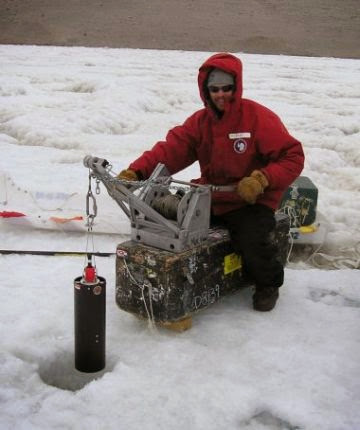 Joel Moore lowers the bbe Fluoroprobe in Lake Bonney, 2004 (photo by A. Chiuchiolo)