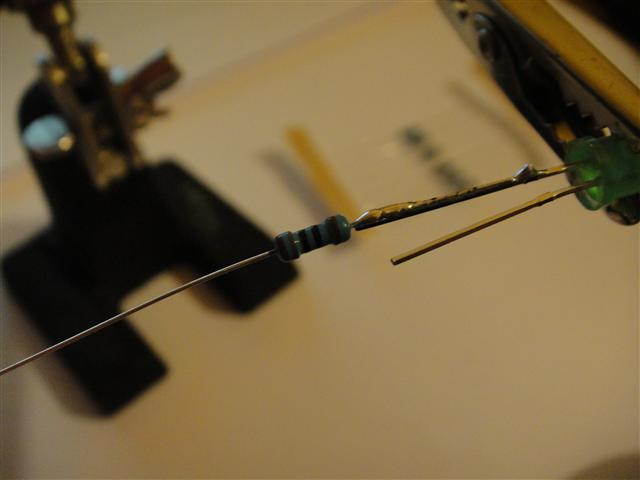 Solder on a 180 ohm resistor to the LEDs annode