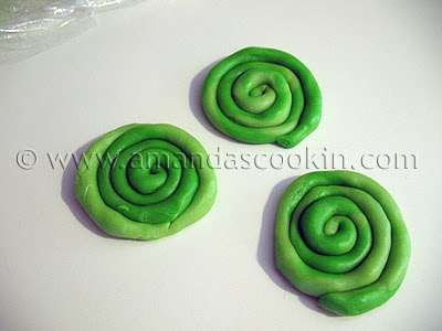A photo of three green cookie dough spirals.