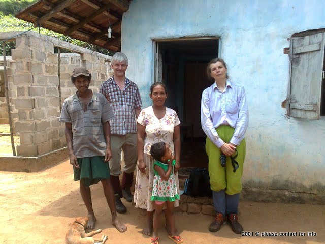 Hospitality - Olga Shakirova n Colin Schaverien with a village family in Sinharaja