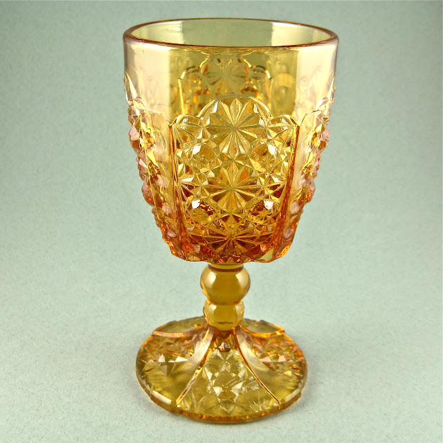 Amber EAPG Goblet Daisy & Button Thumbprint Panels Adams & Co ca 1886