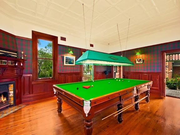 This games room is pure Federation style, with wooden fireplace, polished floor and ornate ceiling panels.