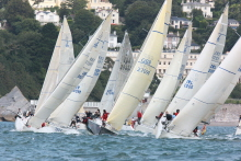 J/109 one-design sailboat- starting on line in Dartmouth, England