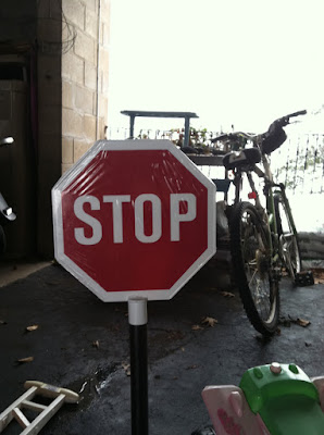stop sign garage bike asphalt stock photo
