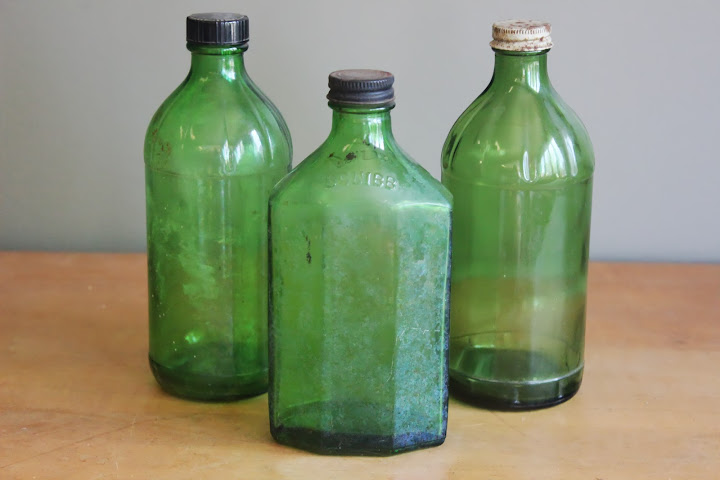 Assorted green bottles available for rent from www.momentarilyyours.com, $1.50 each.