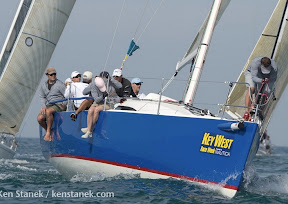 J/111 one-design sailboat- sailing around mark at Key West Race Week