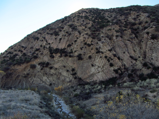 a cliff with many sections that follow the layer