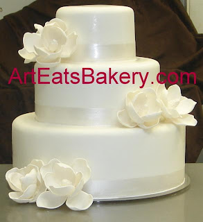 Custom Modern Elegant Three Tier White Fondant Wedding Cake With Hand Painted Pearl Ribbon And Romantic Edible Sugar Magnolia Flowers