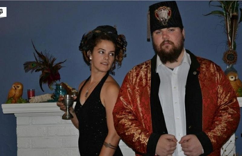 Black RSJ - smug look in hat with pretty girl
