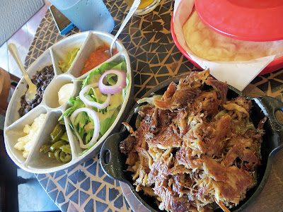 Crispy Duck Fajitas for One at Cafe Mambo, Paia in Maui. All Fajitas are served with Home-made Salsa, Guacamole, Sour Cream, Feta, Jalapenos, Black Beans, Salad and Flour Tortillas