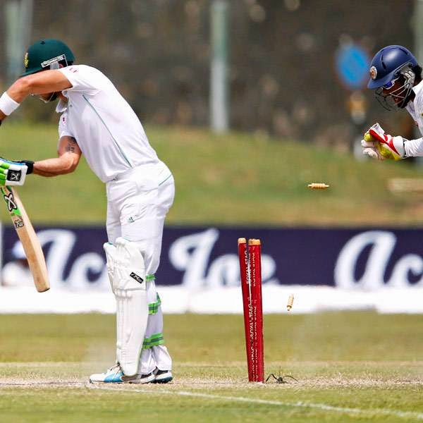 South Africa's Faf du Plessis (L) bowled out by Sri Lanka's Rangana Herath (not pictured) during the fourth day of their first test cricket match in Galle July 19, 2014.