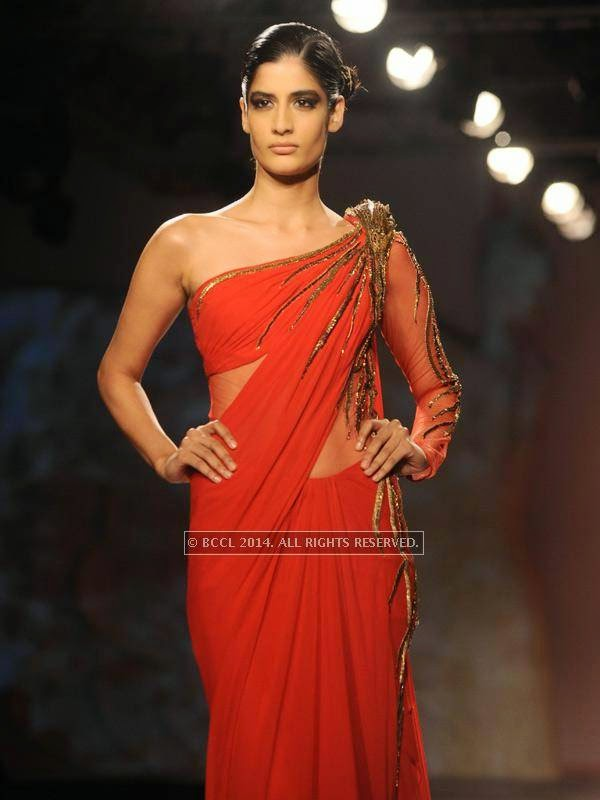 Ericka showcases a creation by designer Gaurab Gupta on Day 3 of India Couture Week, 2014, held at Taj Palace hotel, New Delhi.