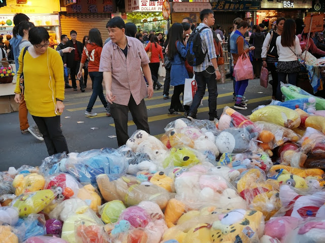 man selling stuffed toys at Sai Yeung Choi Street South