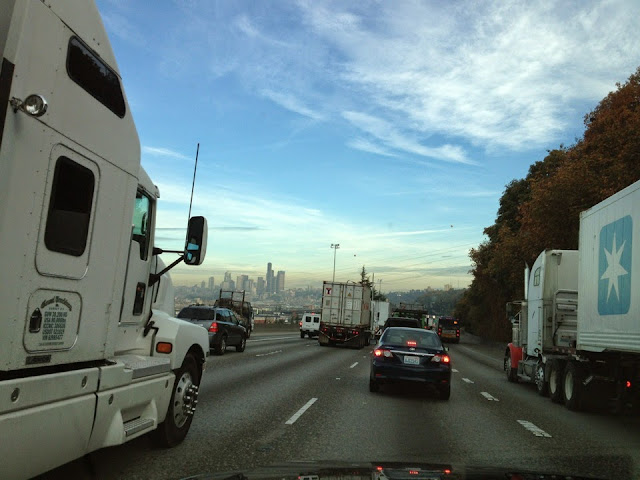 Heading north on Interstate 5, Seattle skyline in the background.