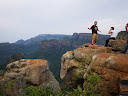 I was talking to some other Peace Corps Volunteers near a lookout for the Three Rondevaals at the Blyde River Canyon... but it looks like I'm doing some stunt at the edge of the canyon!