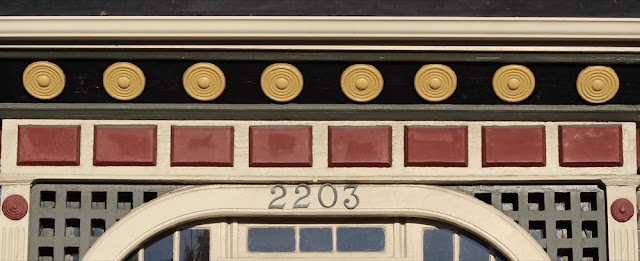 carved and painted cornice over a door