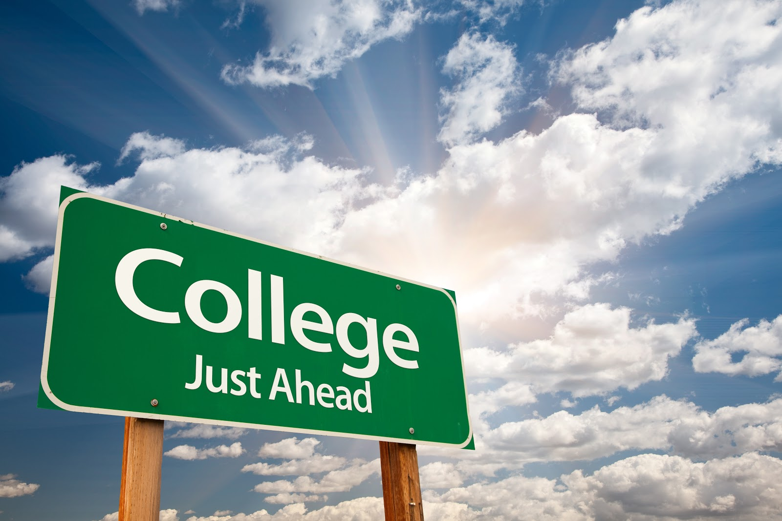 """Road sign, street sign that says """"college just ahead"""""""