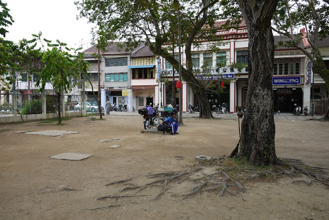 empty dirt area with a few trees in Penang, Malaysia