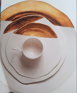 vajilla de loza con toques de cobre