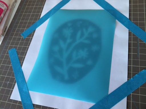 We taped our Martha Stewart Crafts stencil paper over top, and began cutting out Lena's design.