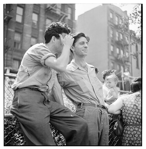 Naked City. Two men leaning against a fence. 1947.