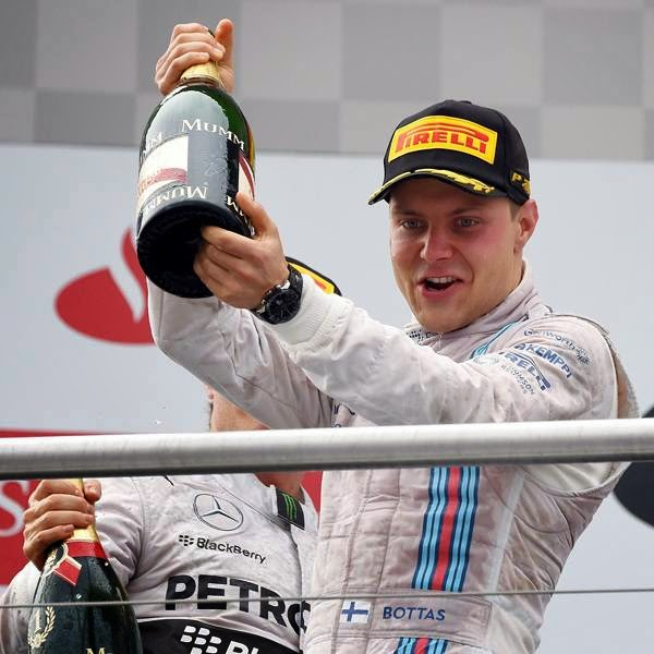 Williams' Finnish second placed driver Valtteri Bottas celebrates after the German Formula One Grand Prix at the Hockenheimring racing circuit in Hockenheim, southern Germany, on July 20, 2014.