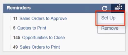 """Choosing the """"set up"""" option from NetSuite's reminders portlet menu."""
