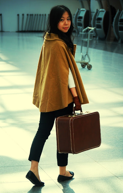 cape vintage suitcase leather gloves