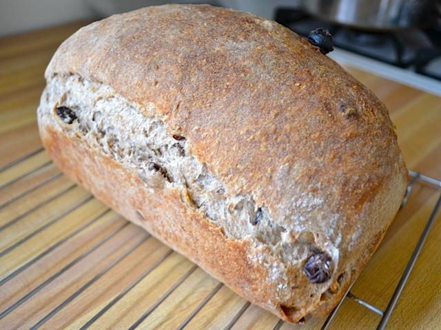 baked raisin spice bread on cooling rack