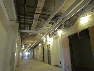 Insulated ducts and pipes in hallway