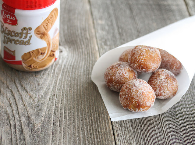 photo of Biscoff Filled Donut Holes in a paper cone