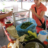 "Holly looking on as food vendor cooks up a ""soup snack"" in Battambang"