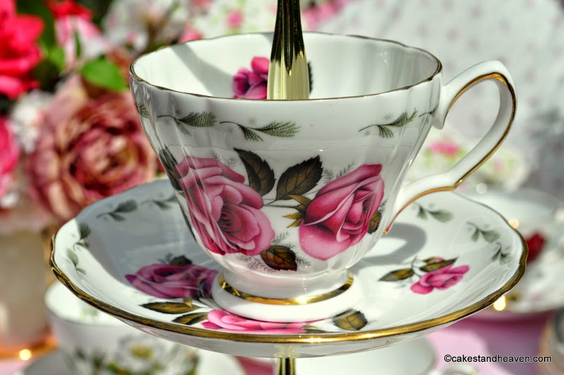 pink rose vintage teacup and saucer on a cake stand
