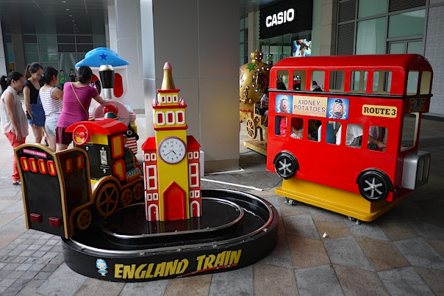 an England Train and a red double-decker bus ride for kids at a mall in Shenzhen, China