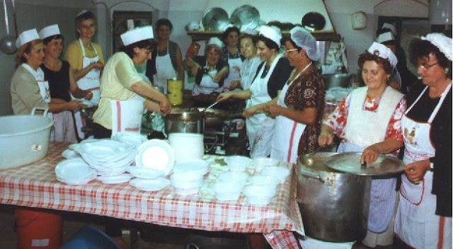 Local lady cooks at Camigliano's village festival