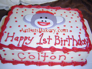 White and red butter cream kid's sock monkey birthday cake
