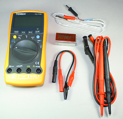 What comes in the box with the Tenma 72-7740 DMM: temperature probe, battery, alligator clips, and probes.