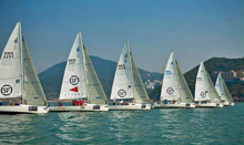 J/80  one-design sailboats- sailing upwind off start in Hong Kong Police Sailing regatta