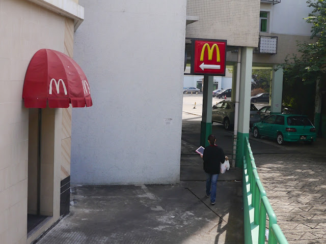 Signs behind a McDonald's in Macau