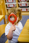 LePort Montessori Preschool Toddler Program Irvine San Marino - child using a magnifying glass