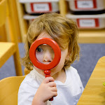 LePort Montessori Preschool Toddler Program Irvine San Marino - child using a magnifying glass
