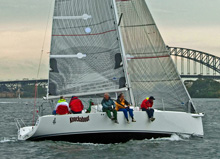 J/97 sailing under Sydney Harbour's famous bridge in Australia