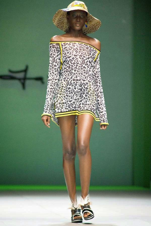 A model presents a creation by South African fashion designer Marianne Fassler on July 24, 2014 during the fashion week at the Cape Town International Convention Centre, in Cape Town, South Africa.
