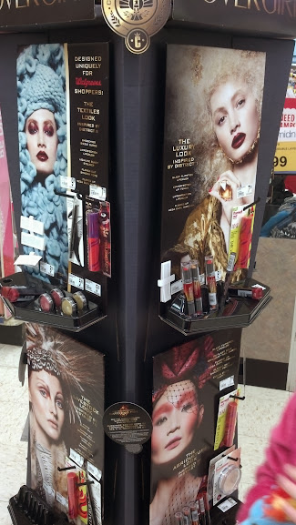 spinning display of Covergirl ads using the districts as themes.